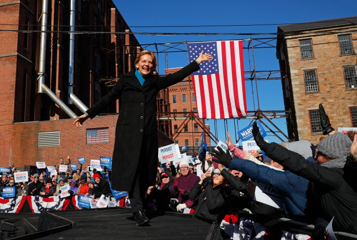 FILE PHOTO: Potential 2020 Democratic presidential nomination candidate U.S. Senator Elizabeth Warren (D-MA) waves at the crowd ahead of a campaign rally in Lawrence, Massachusetts, U.S. February 9, 2019. REUTERS/Brian Snyder