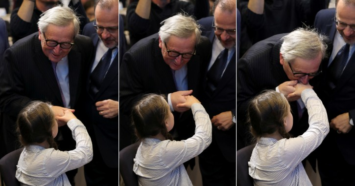 A combination of pictures shows European Commission President Jean-Claude Juncker greeting 16-year old Swedish environmental activist Greta Thunberg at a conference in Brussels, Belgium February 21, 2019.  REUTERS/Yves Herman