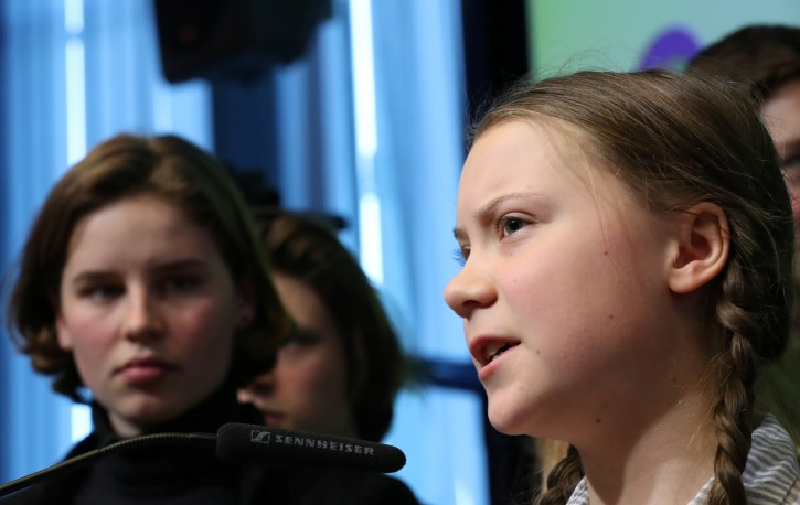 16-year old Swedish environmental activist Greta Thunberg and Anuna De Wever, a Belgian climate student activist attend a conference in Brussels, Belgium February 21, 2019.  REUTERS/Yves Herman