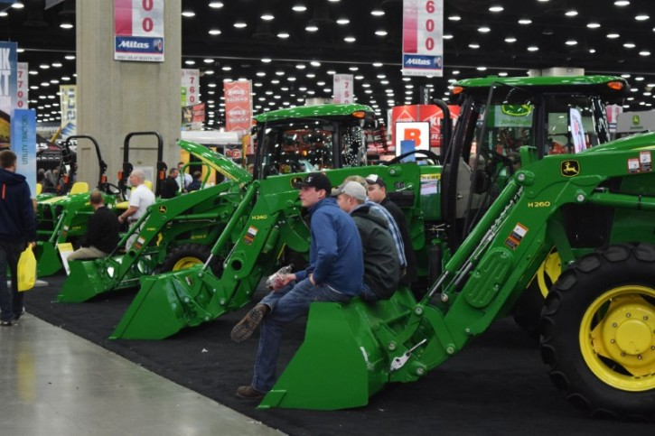 People look at Deere equipment as they attend National Farm Machinery show in Louisville, Kentucky, February 11, 2016. AP
