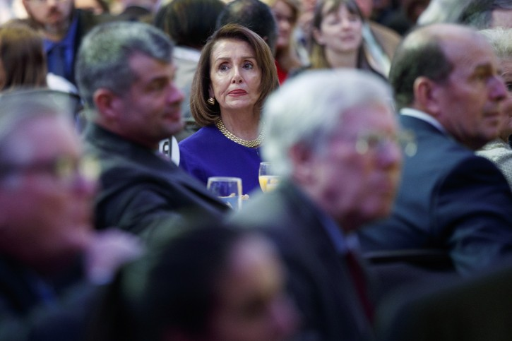 Speaker of the House Nancy Pelosi of Calif. listens during the National Prayer Breakfast attended by President Donald Trump, Thursday, Feb. 7, 2019, in Washington. (AP Photo/ Evan Vucci)