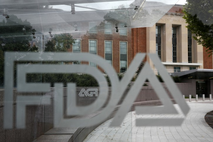 Food and Drug Administration (FDA) signage is seen through a bus stop at the U.S. Department of Health and Human Services, Thursday, Aug. 2, 2018, in Silver Spring, Md., on the FDA grounds. (AP Photo/Jacquelyn Martin)
