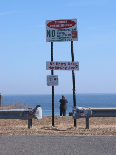 In this Feb. 5, 2019 photo, Andrew Provence, an attorney for the American Littoral Society, looks out at the ocean at the end of a street in Deal, N.J. that the town plans to give up to a private property owner. Beach access advocates fear a popular spot for surfers, fishermen and others to get onto the sand will be blocked off, but the town insists that won't be the case, and the American Littoral Society is suing Deal to try to prevent the transaction. (AP Photo/Wayne Parry)