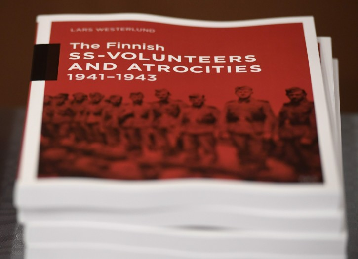 The research document entitled The Finnish SS-volunteers and atrocities 1941 - 1943 against Jews, detailing atrocities against civilians and Prisoners of War in Ukraine and the Caucasus Region, pictured in Helsinki, Finland, on Friday Feb. 8, 2019. AP