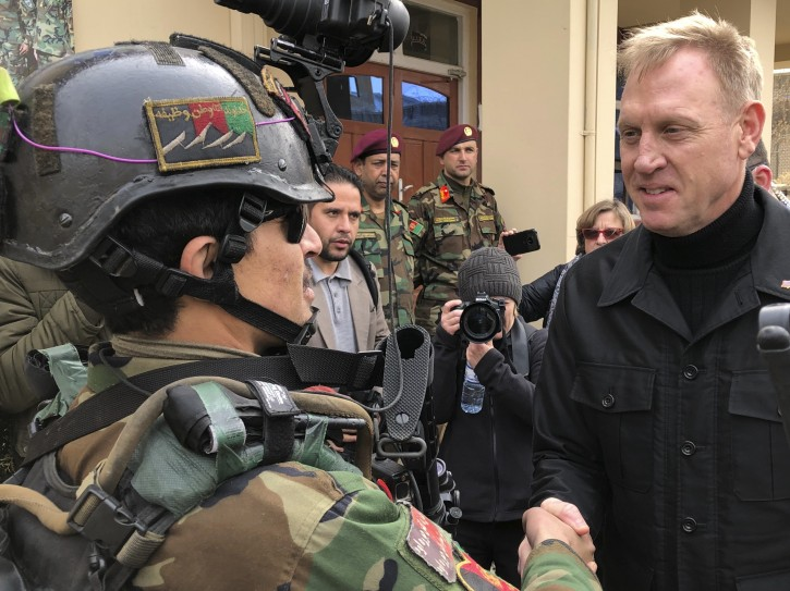 Acting Secretary of Defense Pat Shanahan greets an Afghan commando at Camp Commando, Afghanistan on Monday, Feb. 11, 2019. The unannounced visit is the first for the acting secretary of defense, Pat Shanahan. He previously was the No. 2 official under Jim Mattis, who resigned as defense chief in December.  (AP Photo/Robert Burns)