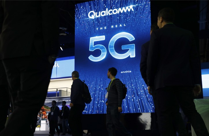 FILE - In this Jan. 9, 2019, file photo a sign advertises 5G at the Qualcomm booth at CES International in Las Vegas. 5G is a new technical standard for wireless networks that promises faster speeds; less lag, or 'latency,' when connecting to the network; and the ability to connect many devices to the internet without bogging it down. (AP Photo/John Locher, File)