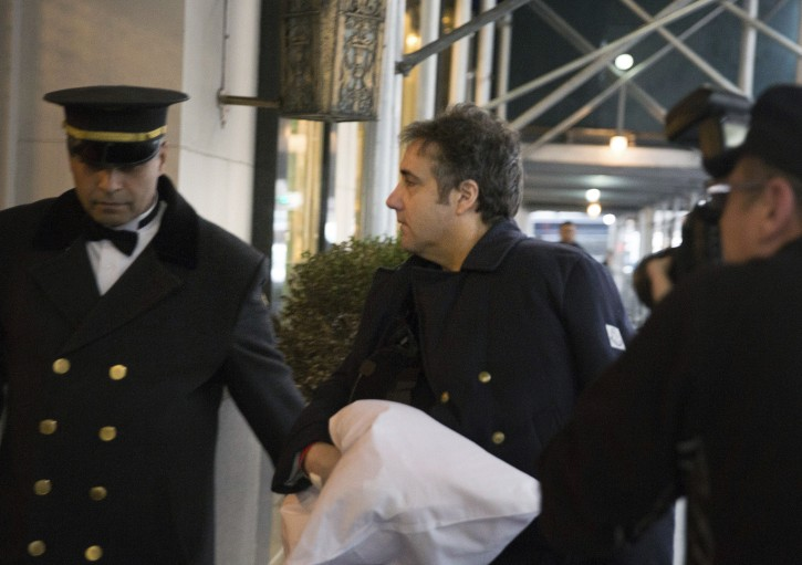FILE - Michael Cohen arrives at his home with his arm in a sling Thursday, Jan. 18, 2019 in New York.  (AP Photo/Kevin Hagen)