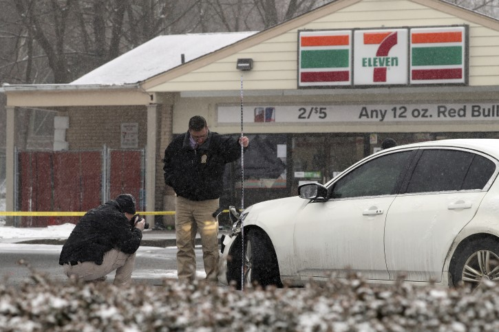 Investigators examine a vehicle outside a convenience store in Garnerville, N.Y., Wednesday, Feb. 20, 2019, after the vehicle reportedly struck and injured several pedestrians, including five children. Police say the driver of the vehicle has been taken into custody for questioning. (Peter Carr/The journal News via AP)