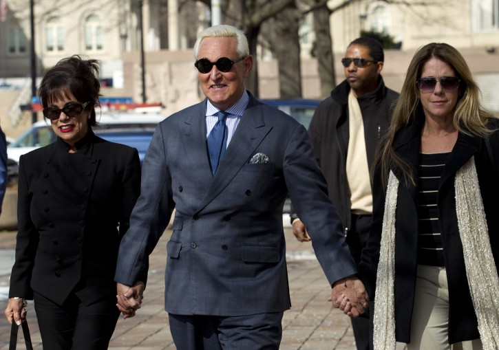 Former campaign adviser for President Donald Trump, Roger Stone accompanied by his wife Nydia Stone, left, and daughter Adria Stone, arrives at federal court in Washington, Thursday, Feb. 21, 2019. Stone was ordered to appear in court over a Instagram post he made about U.S. Judge Amy Berman Jackson. (AP Photo/Jose Luis Magana)