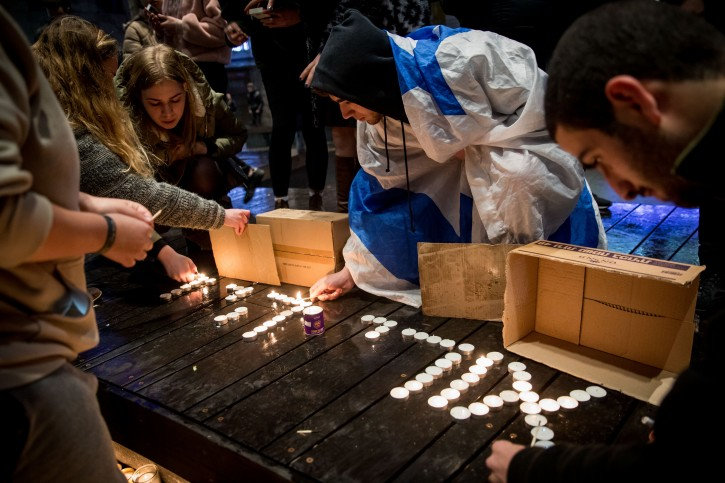 Israelis light candles in memory of 19-year-old Ori Ansbacher, in Zion Square in Jerusalem, on February 9, 2019.  The young woman was found dead two nights prior, in Ein Yael, in the outskirts of Jerusalem, after she was murdered by a Palestinian man. Photo Yonatan Sindel/Flash90