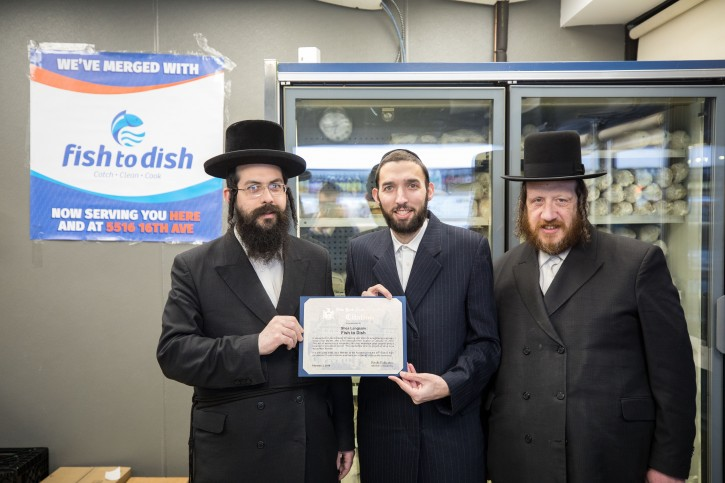 (L-R) Shea Langsam, owner of Fish to Dish; Assembly Member Simcha Eichenstein, presenting citation; Yossi Heimen, owner of Yossi's Fish Market