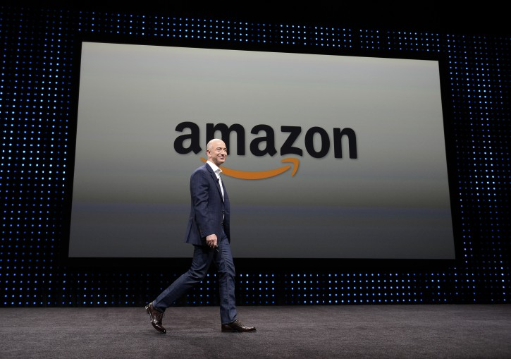 A file photograph showing Amazon CEO Jeff Bezos walking on stage at a press conference. EPA