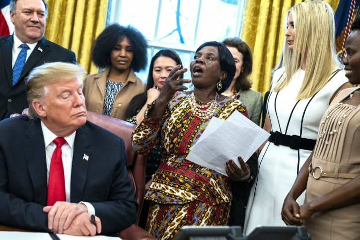 FILE -Ella Zande (C), a Peace Corps beneficiary from Malawi, speaks after US President Donald J. Trump (L) launched the White House global women initiative by signing a national security memorandum in the Oval Office of the White House in Washington, DC, USA, 07 February 2019. Led by First Daughter Ivanka Trump (2-R), the initiative aims to boost women's economic development globally, with emphasis on developing countries.  EPA-EFE/JIM LO SCALZO