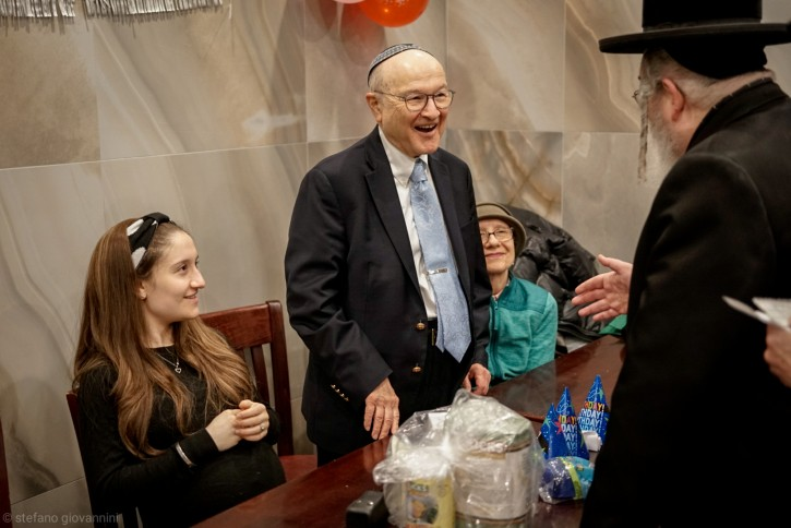Zalmen at Masbia Soup Kitchen greeting people, and handing out $80 to celebrate his 80th Birthday