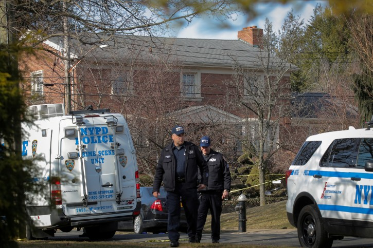 """New York City Police (NYPD) officers investigate the scene where reported New York Mafia Gambino family crime boss, Francesco """"Franky Boy"""" Cali, was killed outside his home in the Staten Island borough of New York City, U.S., March 14, 2019. REUTERS/Brendan McDermid"""