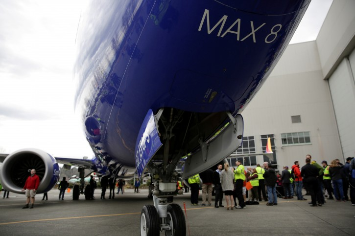 Boeing employees are pictured in front of a 737 MAX 8 produced for Southwest Airlines as Boeing celebrates the 10,000th 737 to come off the production line in Renton, Washington, U.S., March 13, 2018.  REUTERS/Jason Redmond