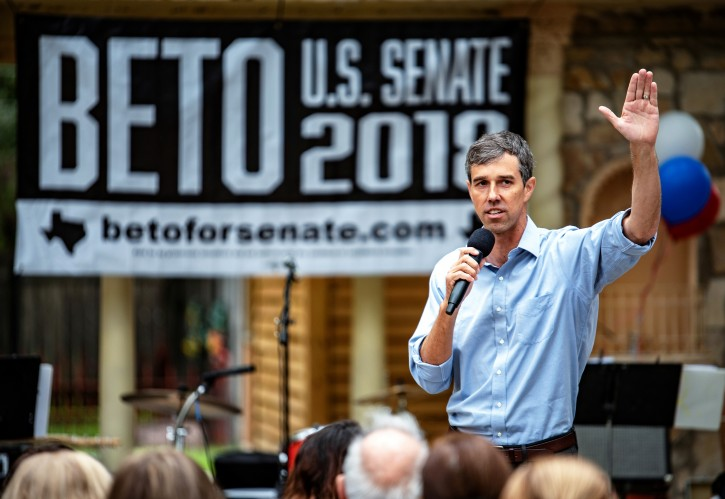 FILE PHOTO:  Representative Beto O'Rourke greets supporters before an event in Del Rio, Texas, U.S. September 22, 2018. Picture taken September 22, 2018. REUTERS/Sergio Flores/File Photo