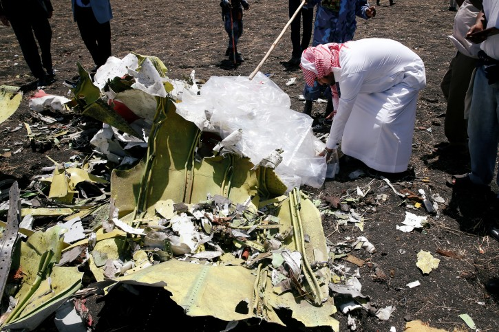 A Saudi man who's brother died in the Ethiopian Airlines Flight ET 302 plane crash, touches a debris after a commemoration ceremony at the scene of the crash, near the town of Bishoftu, southeast of Addis Ababa, Ethiopia March 13, 2019. REUTERS/Baz Ratner