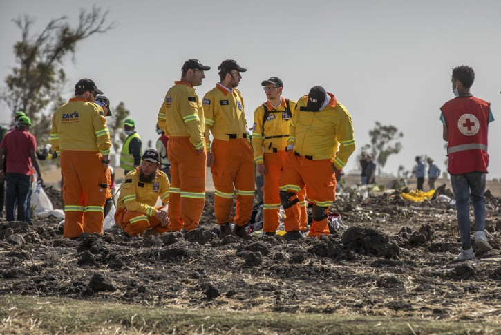 Investigators from Israel examine wreckage at the scene where the Ethiopian Airlines Boeing 737 Max 8 crashed shortly after takeoff on Sunday killing all 157 on board, near Bishoftu, or Debre Zeit, south of Addis Ababa, in Ethiopia Tuesday, March 12, 2019. (AP Photo/Mulugeta Ayene)