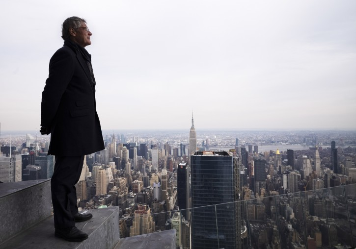 """In this March 8, 2019 photo, Jay Cross, president of Related Hudson Yards, stands on an outdoor observation deck named """"The Edge,"""" 1100 feet (367 meters) off the ground in New York. Located at the new skyscraper known as 30 Hudson Yards, it is scheduled to open to the public at the end of 2019. (AP Photo/Mark Lennihan)"""