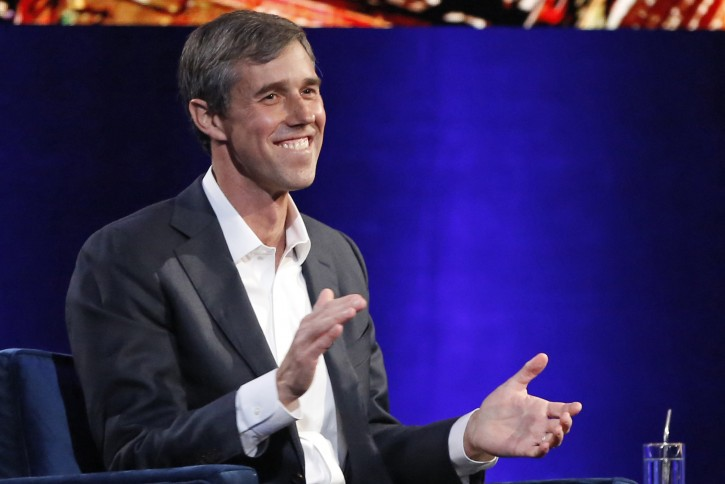 """Former Democratic Texas congressman Beto O'Rourke laughs as with Oprah Winfrey presses him to make the announcement that he is running for president during a live interview on a Times Square stage at """"Oprah's SuperSoul Conversations from Times Square,"""" Tuesday, Feb. 5, 2019, in New York.  (AP Photo/Kathy Willens)"""