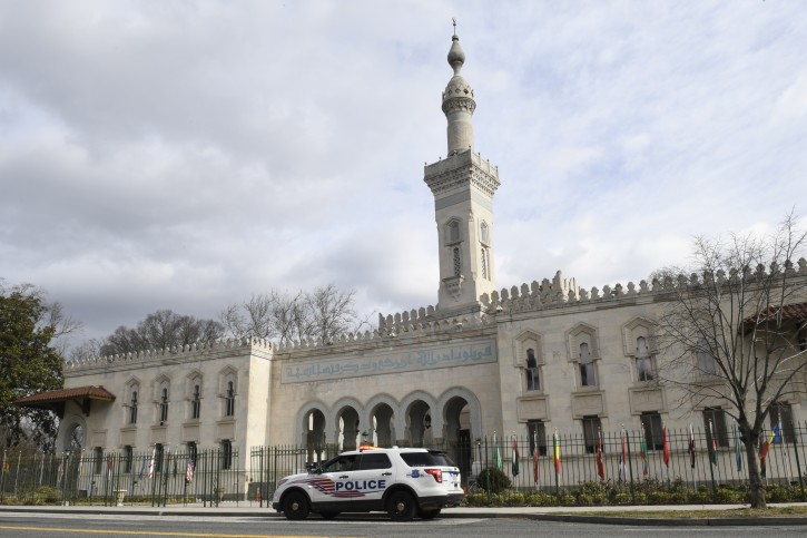 A police vehicle is parked outside the Islamic Center of Washington in Washington, Friday, March 15, 2019. (AP Photo/Susan Walsh)