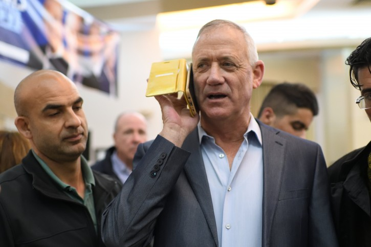 Benny Ganz, Head of Blue and White party speaks on a mobile phone during an elections campaign event  in Petah Tikva on March 13, 2019. Photo by Gili Yaari/Flash90