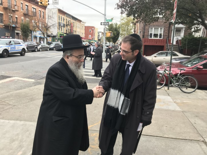 FILE - Yeger soliciting a voter on the streets of Borough Park Nov. 7, 2017 (Eli Wohl/VINnews.com)