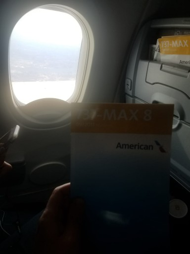 A passenger holds up a 737MAX safety card aboard an American Airlines flight, March, 11, 2019. (VINnews)