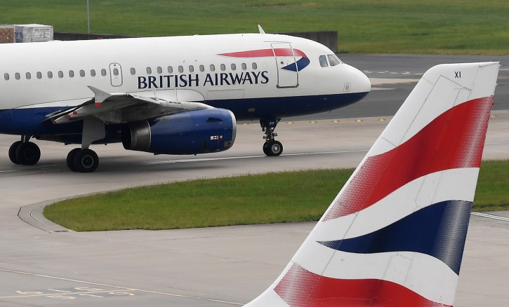 British Airways aircraft stand on their parking positions or taxi at Heathrow Airport in London, Britain, 29 May 2017. EPA