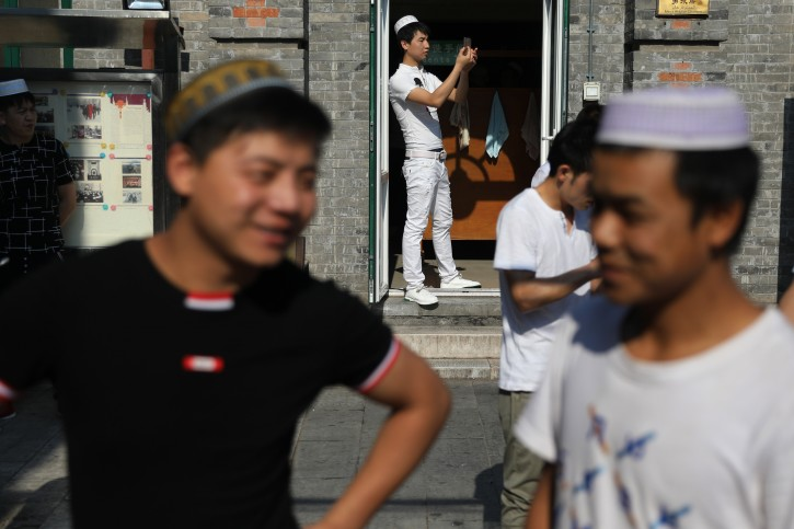 Muslims arrive for prayer at the Niujie Mosque during Eid al-Fitr celebrations in Beijing, China, 26 June 2017. EPA