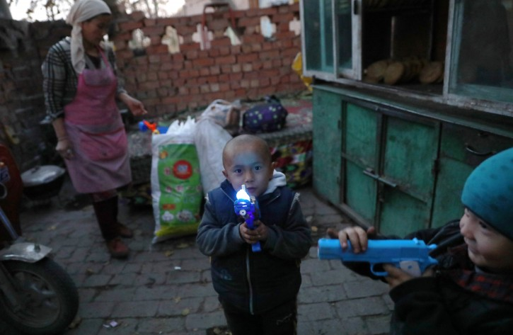 FILE - ) Ethnic Uighur children play with toys in Turpan, Xinjiang Uighur Autonomous Province, China, 17 November 2017. Uighurs, a Muslim ethnic minority group in China, make up about 40 percent of the 21.8 million people in Xinjiang, a vast, ethnically divided region that borders Pakistan, Afghanistan, Kazakhstan, Kyrgyzstan and Mongolia. EPA