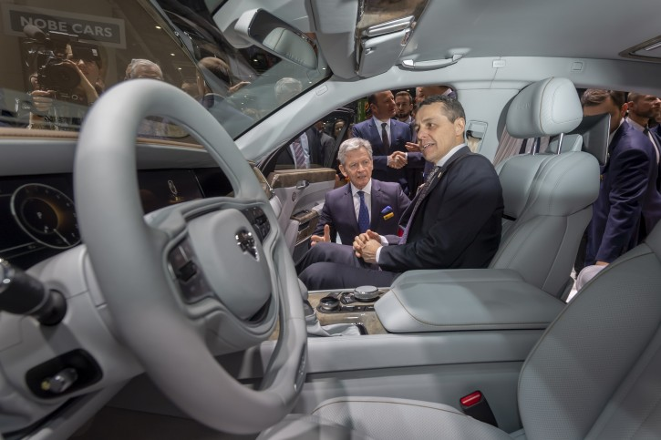 Swiss Foreign Minister Ignazio Cassis sits in a Aurus Senat car during the opening of the 89th Geneva International Motor Show, in Geneva, Switzerland, 07 March 2019. EPA