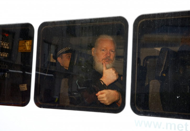 WikiLeaks founder Julian Assange is seen in a police van after was arrested by British police outside the Ecuadorian embassy in London, Britain April 11, 2019. REUTERS/Henry Nicholls