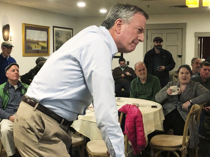 FILE - This March 17, 2019 file photo shows New York Mayor Bill de Blasio listening as he speaks before a group of people at a restaurant in Concord, N.H. (AP Photo/Hunter Woodall)