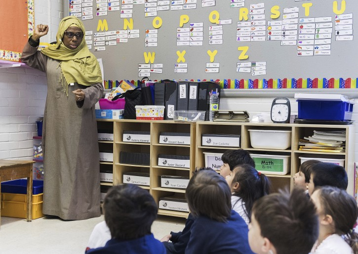 Kindergarten teacher Haniyfa Scott gives a lesson during class in Montreal, Thursday, April 4, 2019. The Quebec government's recently tabled Bill 21 bans the wearing of religious symbols for new government placed employees within schools, the courts and law enforcement. THE CANADIAN PRESS/Graham Hughes