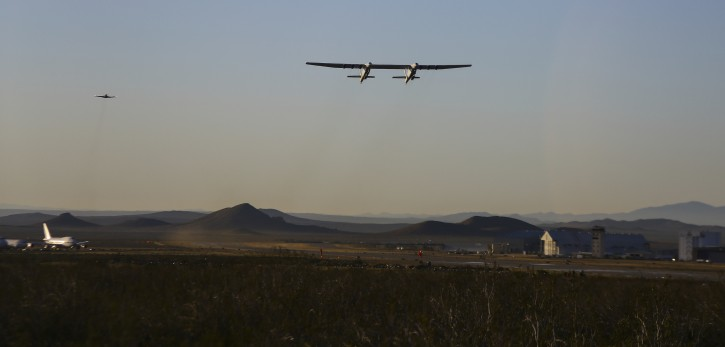 Stratolaunch, a giant six-engine aircraft with the world's longest wingspan , makes its historic first flight from the Mojave Air and Space Port in Mojave, Calif., Saturday, April 13, 2019. Founded by the late billionaire Paul G. Allen, Stratolaunch is vying to be a contender in the market for air-launching small satellites.  (AP Photo/Matt Hartman)