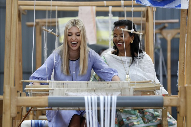 White House senior adviser Ivanka Trump, left, reacts as she tries her hand at a traditional weaving loom at Moya, a manufacturing center of textile and traditional crafts, with Moya founder Sara Abera, Sunday April 14, 2019, in Addis Ababa, Ethiopia. Trump is visiting Ethiopia and later this week the Ivory Coast to promote a White House global economic program for women. (AP Photo/Jacquelyn Martin)