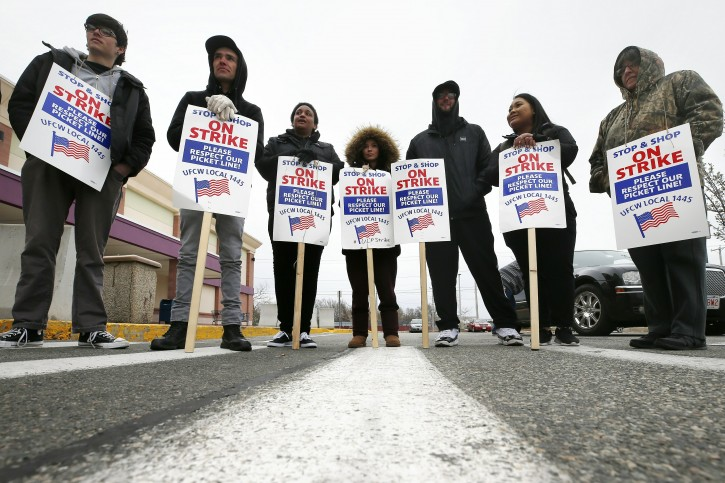 Striking workers stand on a picket line outside the Stop & Shop supermarket in Revere, Mass., Thursday, April 18, 2019. Some Jewish families in southern New England are preparing for Passover without the region's largest supermarket chain. Thousands of workers remain on strike and rabbis in Massachusetts, Connecticut and Rhode Island are advising their congregations not to cross the picket lines. (AP Photo/Michael Dwyer)