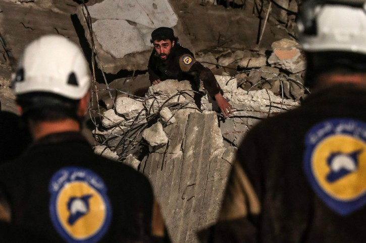 (FILE) - Volunteers of White Helmets search for survivors after an explosion in the city of Idlib, Syria, 09 April 2018, (reissued 22 July 2018). EPA