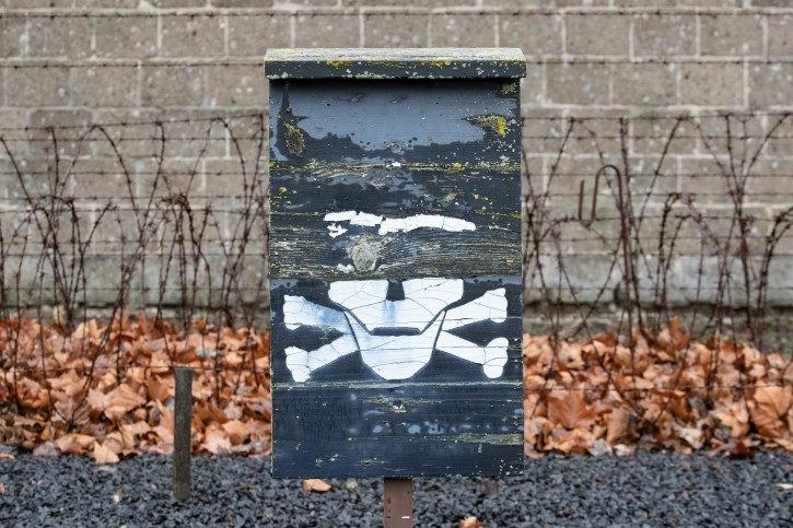 FILE - Barbed wires are seen behind a skeleton sign at the Sachsenhausen concentration camp site in Oranienburg, Germany, 27 January 2019.  EPA