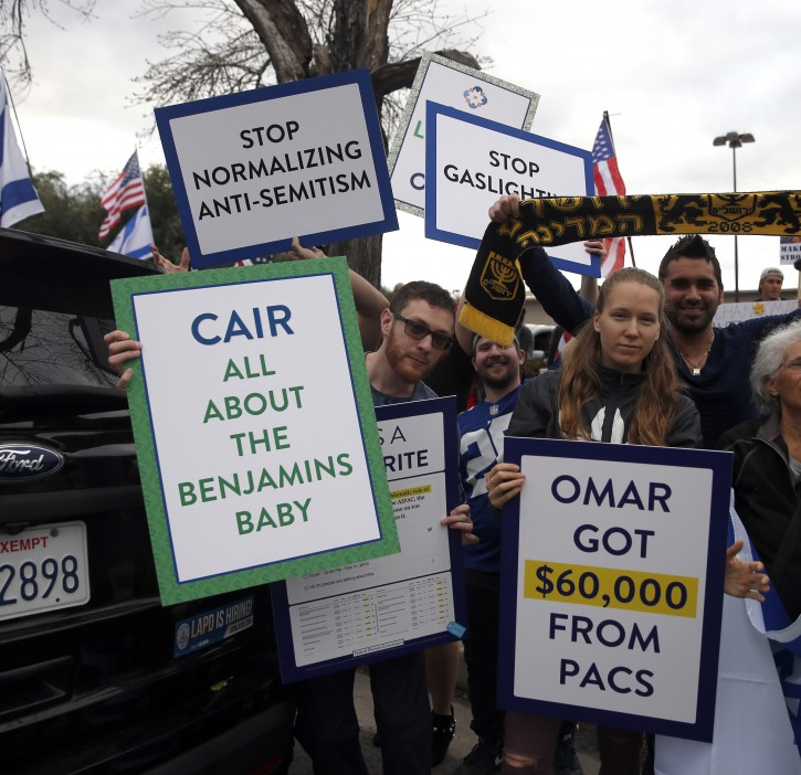 Protesters hold placards during a demonstration against Ilhan Omar, US Representative for Minnesota's 5th congressional district, in Woodland Hills, Los Angelesm California, USA, 23 March 2019. People protested on 23 March after Omar posted a message on social media in February that drew criticism.  EPA-EFE/ADAM S DAVIS