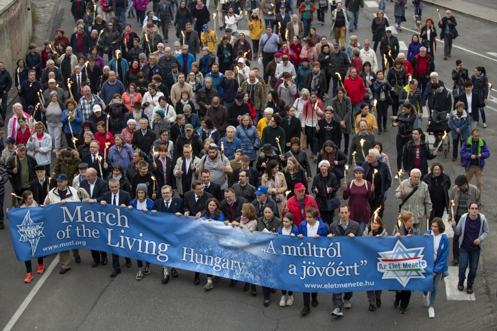 Participants carry a banner during the 17th March of the Living commemoration held for the Hungarian victims of the Holocaust in downtown Budapest, Hungary, 14 April 2019.  EPA-EFE/BALAZS MOHAI