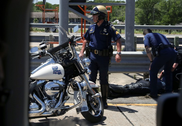 Police officers tend to a fallen colleague after a police motorcycle accident during U.S. President Donald Trump's motorcade in Lake Charles, Louisiana, U.S., May 14, 2019. REUTERS/Leah Millis