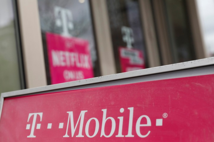 A sign for a T-Mobile store is seen in Manhattan, New York, U.S., April 30, 2018. REUTERS/Shannon Stapleton