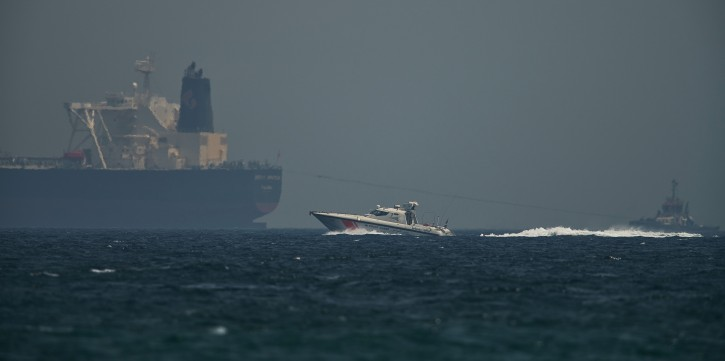 "An Emirati coast guard vessel passes an oil tanker off the coast of Fujairah, United Arab Emirates, Monday, May 13, 2019. Saudi Arabia said Monday two of its oil tankers were sabotaged off the coast of the United Arab Emirates near Fujairah in attacks that caused ""significant damage"" to the vessels, one of them as it was en route to pick up Saudi oil to take to the United States. (AP Photo/Jon Gambrell)"