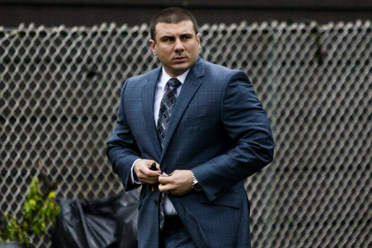 NYPD officer Daniel Pantaleo leaves his house before showing up to court during his trial for Eric Garner dead, Monday, May 13, 2019 in Staten Island, New York. (AP Photo/Eduardo Munoz Alvarez)
