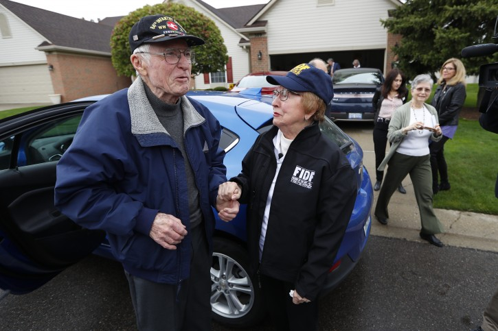 Doug Harvey, 95, and holocaust survivor Sophie Tajch Klisman, 89, right, greet each other in Commerce Township, Mich., Monday, May 13, 2019. Harvey, was a US Army soldier in the 84th Infantry Division, which helped liberate the Salzwedel concentration camp in Nazi Germany and free its captives including Klisman.  (AP Photo/Paul Sancya