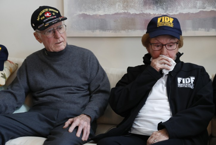 Doug Harvey, 95, and holocaust survivor Sophie Tajch Klisman, 89, right, talk about memories in Commerce Township, Mich., Monday, May 13, 2019. Harvey, was a US Army soldier in the 84th Infantry Division, which helped liberate the Salzwedel concentration camp in Nazi Germany and free its captives including Klisman.  (AP Photo/Paul Sancya