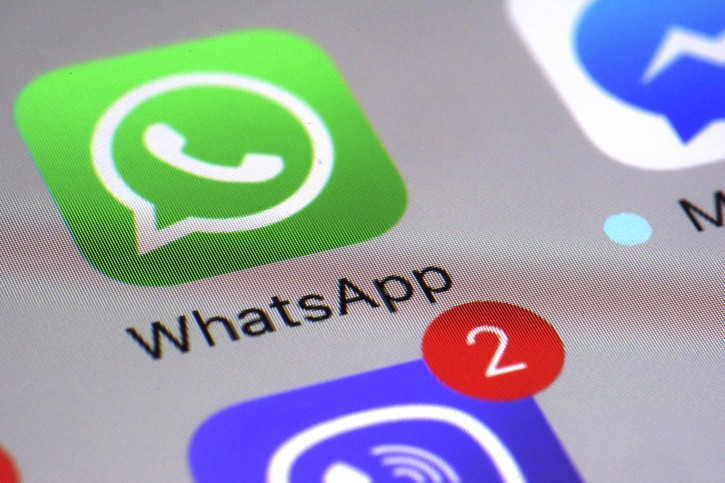 FILE - This Friday, March 10, 2017, file photo shows the WhatsApp communications app on a smartphone, in New York. WhatsApp says a vulnerability in the popular communications app let mobile phones be infected with sophisticated spyware with a missed in-app call alone. (AP Photo/Patrick Sison, File)